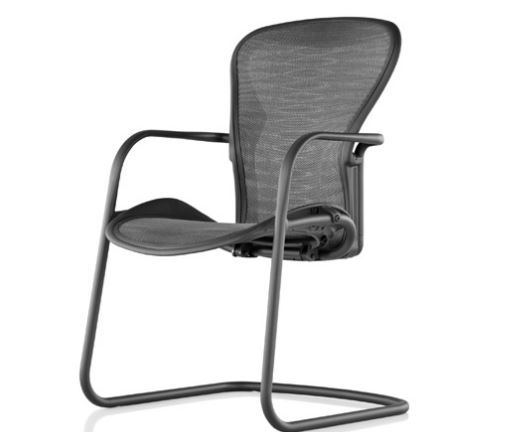 Used Herman Miller Aeron Guest / Side Chair color graphite sled base bottom. Mesh back